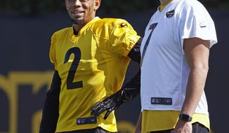 FILE - In this Sept. 4, 2017, file photo, Pittsburgh Steelers newly acquired cornerback Joe Haden (2), talks with quarterback Ben Roethlisberger during an NFL football practice in Pittsburgh. Haden shelled out a small portion of his $27 million contract to secure his familiar No. 21 with the Pittsburgh Steelers instead of the No. 2. (AP Photo/Gene J. Puskar, File)