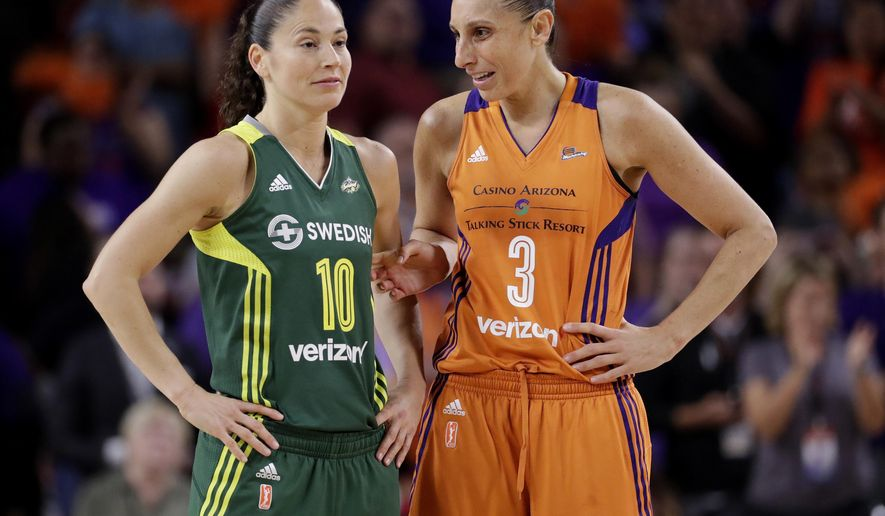 Phoenix Mercury guard Diana Taurasi (3) talks with Seattle Storm guard Sue Bird (10) during the second half of a single-game WNBA basketball playoff matchup, Wednesday, Sept. 6, 2017, in Tempe, Ariz. Phoenix won 79-69. (AP Photo/Matt York)