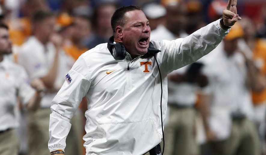 Tennessee head coach Butch Jones signals to his players in the second half of an NCAA college football game against the Georgia Tech, Monday, Sept. 4, 2017, in Atlanta. (AP Photo/John Bazemore)