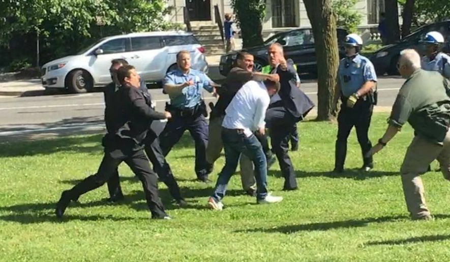 A pro-Kurdish protestor is surrounded and beaten by Turkish security officials after a peaceful protest against Turkish President Recep Tayipp Erdogan turned violent outside the Turkish Ambassador's Residence in D.C. in May. (Courtesy Mehmet Tankan)