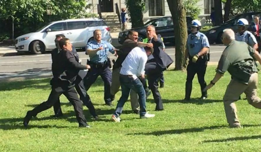 A pro-Kurdish protestor is surrounded and beaten by Turkish security officials after a peaceful protest against Turkish President Recep Tayipp Erdogan turned violent outside the Turkish Ambassador's Residence in D.C. in May. (Courtesy of Pouyan Bokaei)