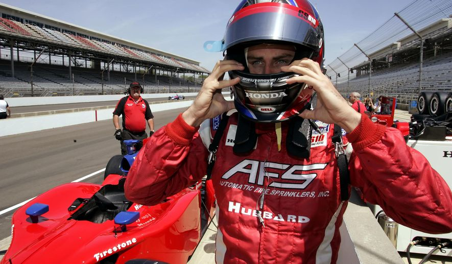 """FILE - In this May 8, 2006, file photo, driver Arie Luyendyk Jr.adjust his helmet as he prepares to practice for the 90th running of the Indianapolis 500 at the Indianapolis Motor Speedway in Indianapolis. Luyendyk was announced as the leading man for ABC's """"The Bachelor"""" on Sept. 7, 2017. (AP Photo/Tom Strattman, File)"""