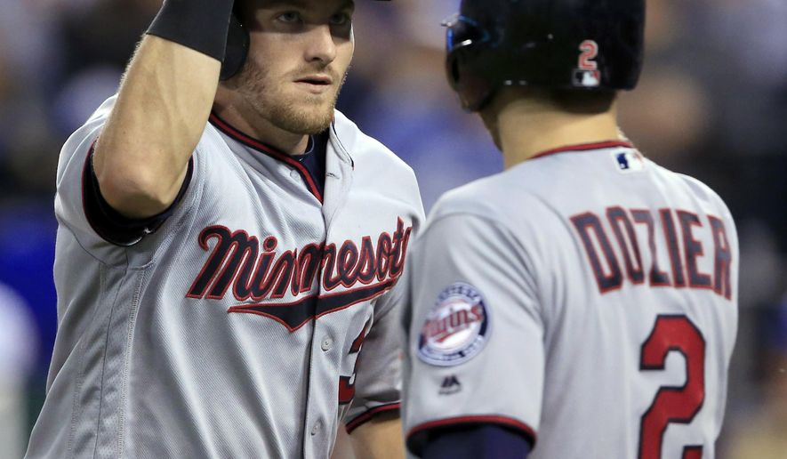 Minnesota Twins designated hitter Robbie Grossman, left, is congratulated by Brian Dozier (2) after his solo home run off Kansas City Royals starting pitcher Sam Gaviglio during the fifth inning of a baseball game at Kauffman Stadium in Kansas City, Mo., Thursday, Sept. 7, 2017. (AP Photo/Orlin Wagner)