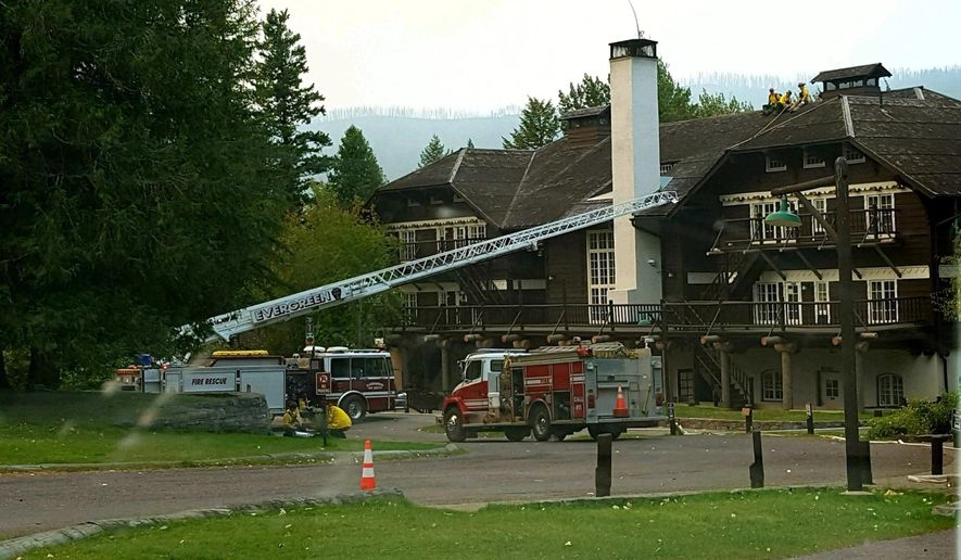 In this Sept. 4, 2017 photo provided by Inciweb, fire crews preparing to assist in structural protection of Lake McDonald Lodge Glacier National Park, Mont. High-capacity pumps, pipes, and sprinklers are headed for the lodge on Wednesday, Sept. 7, 2017, to create a curtain of water, if necessary, to hold off a wildfire that already destroyed a century-old backcountry chalet. (Inciweb via AP)