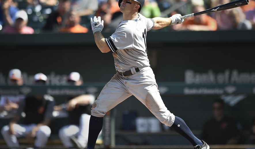 New York Yankees' Brett Gardner connects for a double against the Baltimore Orioles in the fourth inning of a baseball game, Thursday, Sept. 7, 2017, in Baltimore. (AP Photo/Gail Burton)
