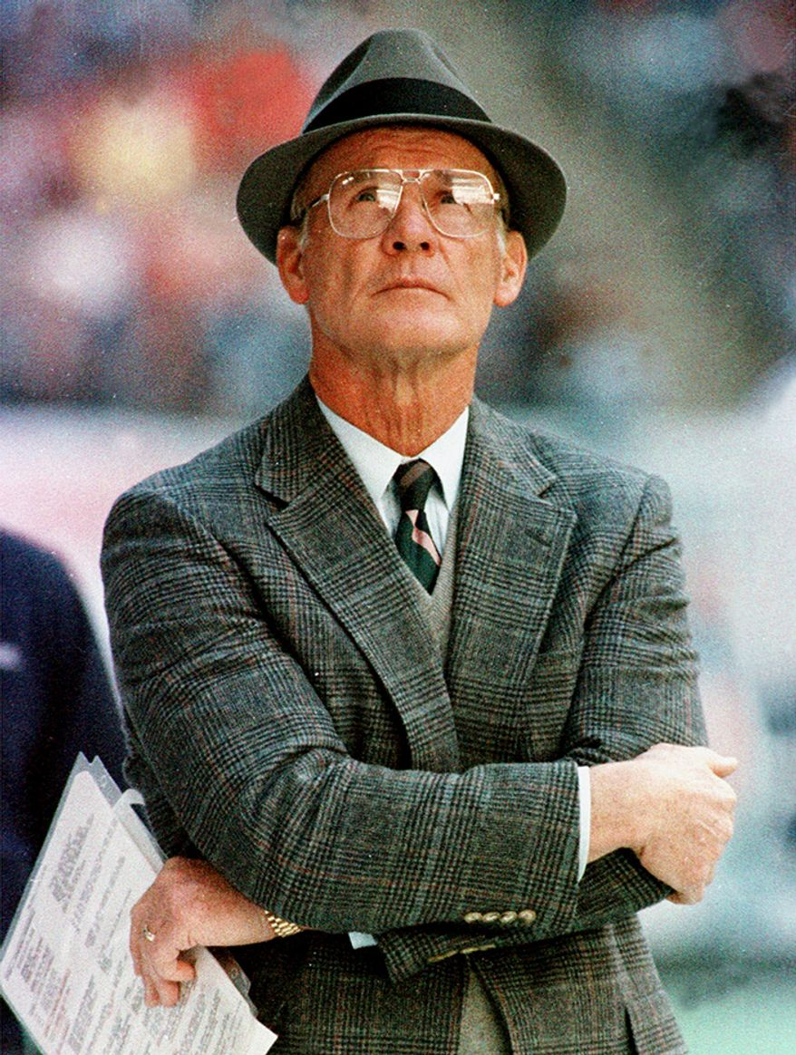 """8. Tom Landry (1960-1988) ranks as one of the greatest and most innovative coaches in NFL history, creating many new formations and methods. He invented the now popular 43 defense, and the """"flex defense"""" system made famous by the """"Doomsday Defense"""" squads he created during his 29-year tenure with the Dallas Cowboys. His 29 consecutive years as the coach of one team are an NFL record, along with his 20 consecutive winning seasons. Landry won two Super Bowl titles (VI, XII), five NFC titles, 13 Divisional titles, and compiled a 2701786 record, the third-most wins all-time for an NFL coach. His 20 career playoff victories are the second most of any coach in NFL history. He was named the NFL Coach of the Year in 1966 and the NFC Coach of the Year in 1975. His most impressive professional accomplishment is his 20 consecutive winning seasons (19661985), an NFL record that remains unbroken and unchallenged. From 1966 to 1982 Dallas played in 12 NFL or NFC Championship games, a span of 17 years. More impressive is the Cowboys' appearance in 10 NFC Championship games in the 13-year span from 1970 to 1982. Leading the Cowboys to three Super Bowl appearances in four years between 1975 and 1978, and five in nine years between 1970 and 1978, and being on television more than any other NFL team is what spawned the title of """"America's Team"""""""
