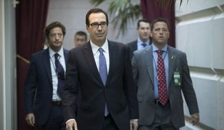 Treasury Secretary Steven Mnuchin arrives for a closed-door meeting with Speaker of the House Paul Ryan, R-Wis., and House Republicans, at the Capitol in Washington, Friday, Sept. 8, 2017. (AP Photo/J. Scott Applewhite) ** FILE **