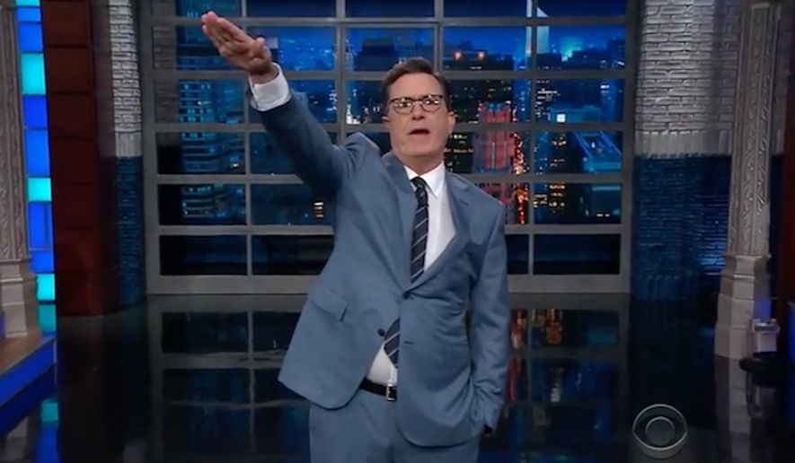 """Late-night comedian Stephen Colbert threw the Nazi salute several times while mocking President Trump Thursday night on """"The Late Show."""" (CBS)"""