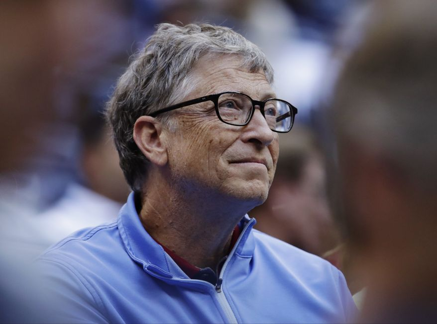 Microsoft founder Bill Gates watches play between Pablo Carreno Busta, of Spain, and Kevin Anderson, of South Africa, during the semifinals of the U.S. Open tennis tournament in New York on Sept. 8, 2017. (Associated Press) **FILE**