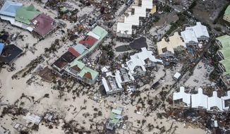 This Sept. 6, 2017, photo provided by the Dutch Defense Ministry shows storm damage in the aftermath of Hurricane Irma, in St. Maarten. Irma cut a path of devastation across the northern Caribbean, leaving thousands homeless after destroying buildings and uprooting trees. Significant damage was reported on the island that is split between French and Dutch control. (Gerben Van Es/Dutch Defense Ministry via AP)