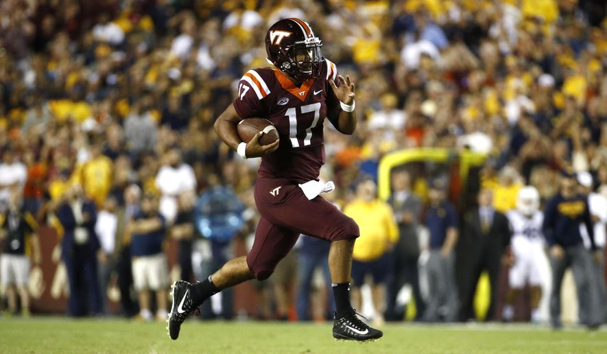 FILE - In this Sept. 3, 2017, file photo, Virginia Tech quarterback Josh Jackson rushes the ball in the second half of an NCAA college football game against West Virginia in Landover, Md. Jackson is hoping to build on his big starting debut when the Hokies play host to Delaware. (AP Photo/Patrick Semansky, File)