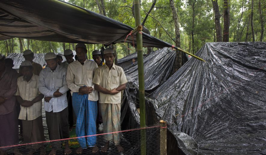 "Rohingya Muslims, who have recently crossed over the border from Myanmar into Bangladesh, offer Friday prayers at a makeshift mosque in Kutupalong, Bangladesh, Friday, Sept. 8, 2017. The U.N. said Friday that an ""alarming number"" of 270,000 Rohingya Muslims have fled violence in Myanmar by crossing into Bangladesh in the last two weeks. (AP Photo/Bernat Armangue)"