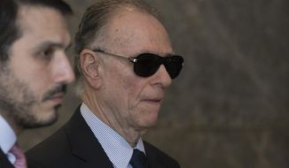 FILE - In this Sept. 5, 2017 file photo, Carlos Nuzman, president of the Brazilian Olympic committee, arrives at Federal Police headquarters in Rio de Janeiro, Brazil, for police questioning this week in a vote-buying scheme to land last year's Rio Olympics. Federal police searched Nuzman's house Tuesday morning. Senior IOC member Richard Pound is urging the body to act decisively in the case of Nuzman. (AP Photo/Leo Correa, File)