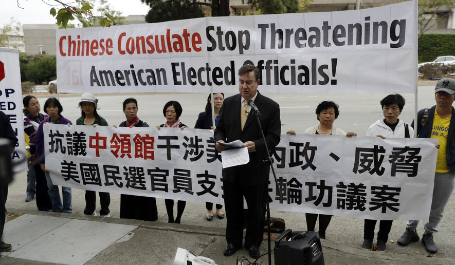 State Sen. Joel Anderson, R-Alpine, center, speaks during a protest organized by Falun Gong practitioners outside the Chinese consulate Friday, Sept. 8, 2017, in San Francisco. Anderson says his attempt to stand up for practitioners of the banned Chinese spiritual movement is being squashed under pressure from the government of China. The Senate last week shelved a symbolic resolution condemning persecution of Falun Gong practitioners after lawmakers received a letter from the Chinese consulate. The letter says the resolution may offend the people of China and damage the relationship between California and China. (AP Photo/Marcio Jose Sanchez)