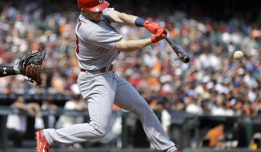 St. Louis Cardinals' Harrison Bader connects for an RBI-double off San Francisco Giants' Kyle Crick in the seventh inning of a baseball game Sunday, Sept. 3, 2017, in San Francisco. (AP Photo/Ben Margot)