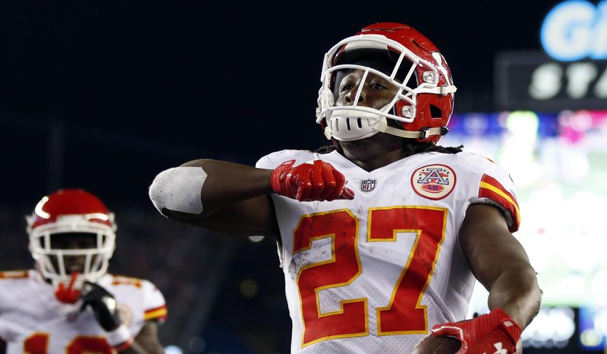 Kansas City Chiefs running back Kareem Hunt (27) celebrates his touchdown against the New England Patriots during the first half of an NFL football game, Thursday, Sept. 7, 2017, in Foxborough, Mass. (AP Photo/Michael Dwyer)