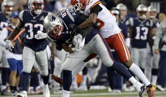 New England Patriots tight end Rob Gronkowski (87) carries Kansas City Chiefs safety Eric Berry (29) on his back after catching a pass during the first half of an NFL football game, Thursday, Sept. 7, 2017, in Foxborough, Mass. (AP Photo/Steven Senne)