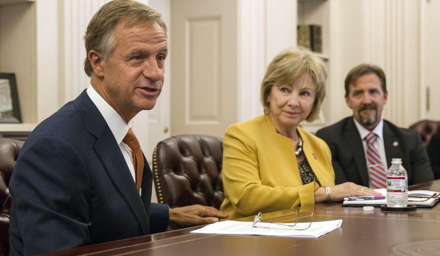 Tennessee Gov. Bill Haslam speaks at a press conference at the state Capitol in Nashville, Tenn., on Friday, Sept. 8, 2017, about a federal judge dismissing a longstanding lawsuit over the state's treatment of people with intellectual and developmental disabilities. To his right are Commissioner Debra K. Payne and Assistant Commissioner Jordan Allen of the state Department of Intellectual and Developmental Disabilities. (AP Photo/Erik Schelzig)