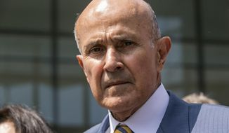 FILE - In this May 12, 2017, file photo, former Los Angeles County Sheriff Lee Baca leaves federal court in Los Angeles after he was sentenced to three years in prison for obstructing an FBI investigation into abuses at the jails he ran. Baca will remain out of federal prison, at least temporarily, as he appeals his conviction for trying to derail an FBI investigation into abuses in the nation's largest jail system. Baca filed an appeal Friday, Sept. 8, 2017 with the 9th U.S. Circuit Court of Appeal. He was due to surrender on Monday but the appeal triggers an automatic stay of that order. (AP Photo/Damian Dovarganes, File)