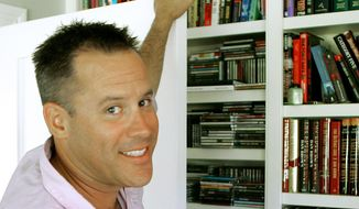 """FILE - This Sept. 2, 2005 file photo shows best-selling author Vince Flynn in the library of his Edina, Minn. home. The late Minnesota author's counterterrorism operative Mitch Rapp is coming to the big screen in """"American Assassin."""" Flynn, who wrote a series of thrillers featuring Rapp, died in 2013 after battling prostate cancer. (AP Photo/Jim Mone, File)"""