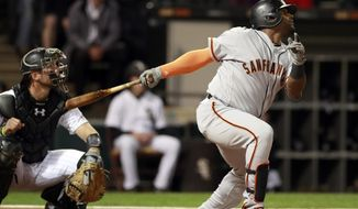 San Francisco Giants third baseman Pablo Sandoval, right, watches his fly-out to the left field with Chicago White Sox catcher Kevan Smith during the second inning of a baseball game in Chicago, Friday, Sept. 8, 2017. (AP Photo/Jeff Haynes)