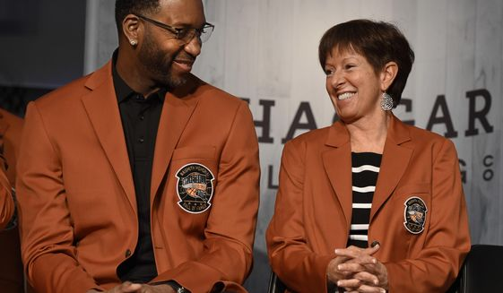 Inductees into the Basketball Hall of Fame Tracy McGrady, left, and Muffet McGraw, smile as they sit together during a news conference at the Naismith Memorial Basketball Hall of Fame, Thursday, Sept. 7, 2017, in Springfield, Mass. (AP Photo/Jessica Hill)