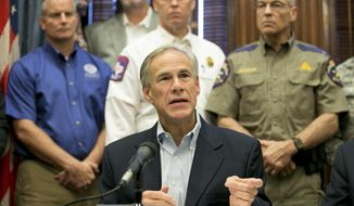 Gov. Greg Abbott talks about the effort to recover from Hurricane Harvey at a news conference at the Capitol in Austin, Texas, on Thursday, Sept. 7, 2017. (Jay Janner/Austin American-Statesman via AP)