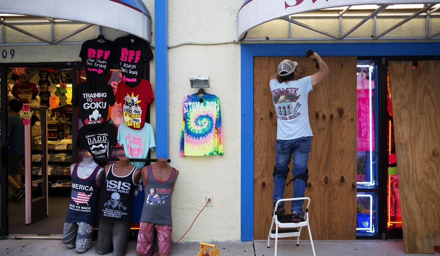 Jone Yoon boards up his beach souvenir shop ahead of Hurricane Irma in Daytona Beach, Fla., Thursday, Sept. 7, 2017. South Florida officials are expanding evacuation orders as Hurricane Irma approaches, telling more than a half-million people to seek safety inland. (AP Photo/David Goldman)