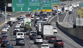 Heavy traffic traveling north bound on Interstate 75 moves slowly, as a major evacuation has begun in preparation for Hurricane Irma, Friday, Sept. 8, 2017, in Forrest Park, south of Atlanta.  (AP Photo/Mike Stewart)