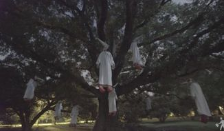 Police in Richmond, Virginia, closed a city park Thursday after the anarchist collective Indecline hanged multiple effigies of clowns in Ku Klux Klan robes from a large tree. (Indecline)