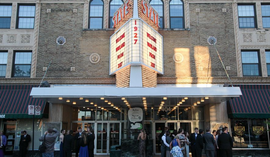 In this April 22, 2017 photo, Wayland students celebrated Prom 2017 at the State Theatre in Kalamazoo, Mich. The building is celebrating its 90th year with music and classic and iconic movies.(Jake Green/Kalamazoo Gazette-MLive Media Group via AP)