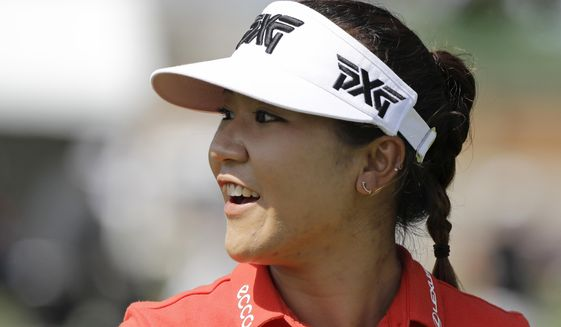 Lydia Ko, of New Zealand, smiles as she walks off the ninth tee during the second round of the Indy Women in Tech Championship golf tournament, Friday, Sept. 8, 2017, in Indianapolis. (AP Photo/Darron Cummings)