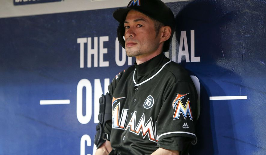 Miami Marlins' Ichiro Suzuki sits in the dugout in the sixth inning of a baseball game against the Atlanta Braves, Thursday, Sept. 7, 2017, in Atlanta. (AP Photo/Brett Davis)