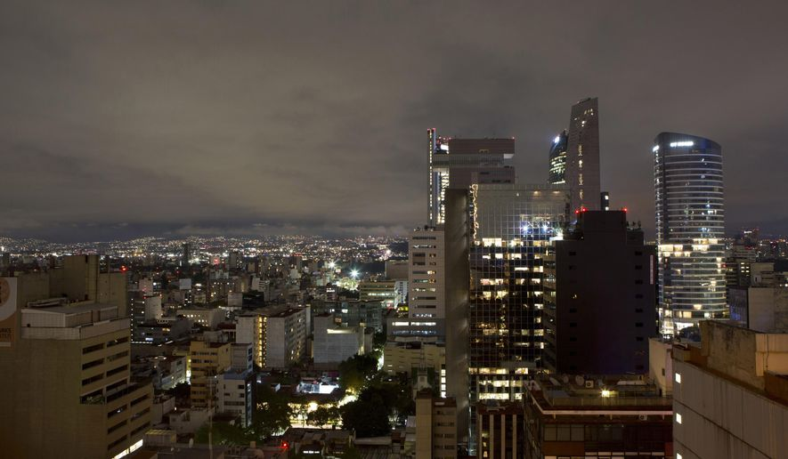 A general view of Mexico City after an earthquake, in the early morning hours of Friday, Sept. 8, 2017. A massive 8.1-magnitude earthquake hit off Mexico's southern coast, toppling houses in Chiapas state, causing at least three deaths and setting off a tsunami warning, officials said Friday.(AP Photo/Rebecca Blackwell)