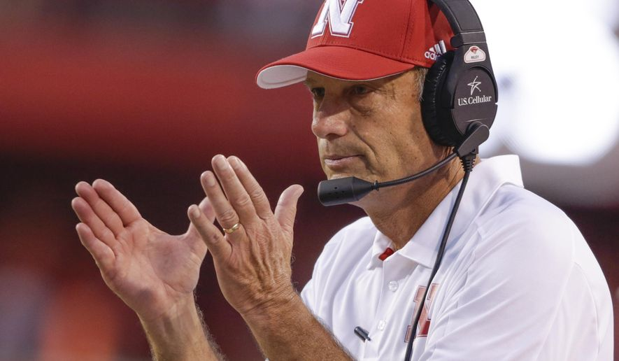 FILE - In this Sept. 2, 2017, file photo, Nebraska head coach Mike Riley applauds after a play review confirmed a touchdown by wide receiver Stanley Morgan Jr. during the first half of an NCAA college football game against Arkansas State in Lincoln, Neb. The former Oregon State Beavers' coach is bringing his new team to Autzen Stadium for a high-profile early season game against Oregon on Saturday, Sept. 9. (AP Photo/Nati Harnik, file)