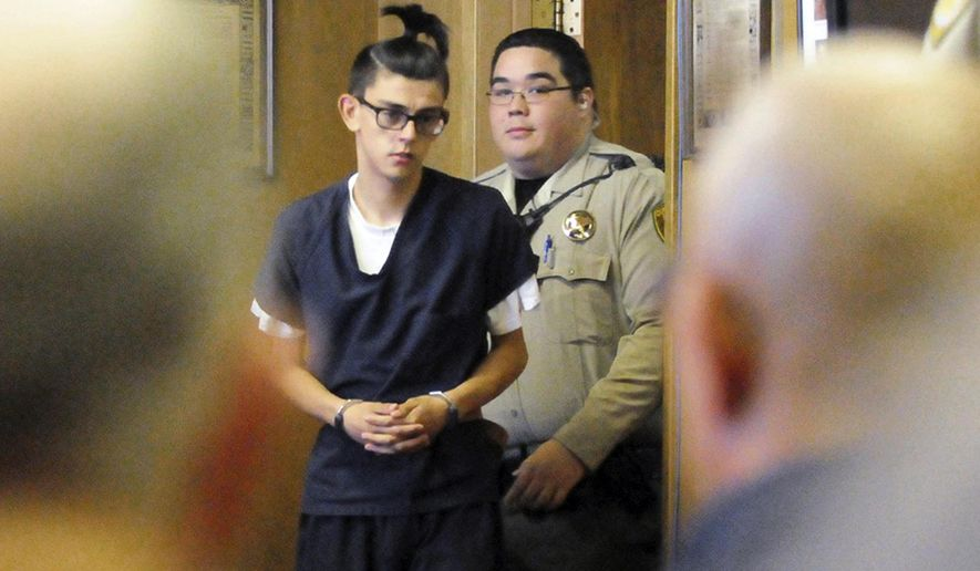 FILE - In this Aug. 31, 2017, file photo, Nathaniel Jouett, accused of fatally shooting two workers inside a public library and wounding four others, enters a courtroom in Clovis, N.M. Sixteen-year-old Jouett is facing charges of first-degree murder, assault, aggravated battery and child abuse in the Aug. 29 shooting at the Clovis-Carver Public Library and prosecutors are taking their case to a grand jury as they pursue adult sanctions against the high school sophomore. (Tony Bullocks/The Eastern New Mexico News via AP, File)