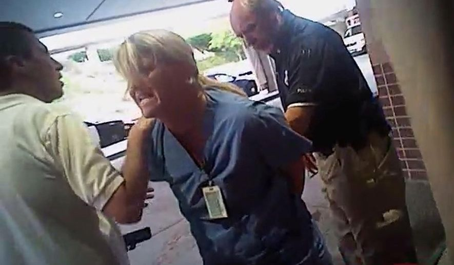FILE - In this July 26, 2017, frame grab from video taken from a police body camera and provided by attorney Karra Porter, nurse Alex Wubbels is arrested by a Salt Lake City police officer at University Hospital in Salt Lake City. Authorities say a Utah police officer whose rough arrest of a nurse has drawn condemnation put the woman in handcuffs even after investigators told him not to worry about getting a blood sample. (Salt Lake City Police Department/Courtesy of Karra Porter via AP, File)