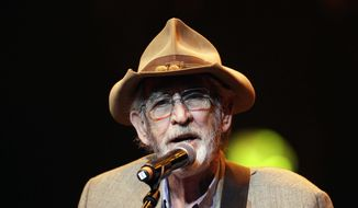 "FILE - In this April 10, 2012 file photo, Don Williams performs during the All for the Hall concert in Nashville, Tenn. Williams, an award-winning country singer with love ballads like ""I Believe in You,"" died Friday, Sept. 8, 2017, after a short illness. He was 78. (AP Photo/Mark Humphrey, File)"