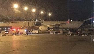 This photo provided by Shawn Woodward shows the scene on the tarmac at the Miami Airport, Thursday, Sept. 7, 2017. Police said they were investigating an officer-involved shooting Thursday night at the Miami airport that shut down a terminal as people looked to leave Florida ahead of Hurricane Irma. Police said in a statement that they were responding, but no other details were immediately available. (Shawn Woodward via AP)