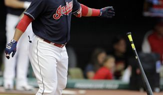 Cleveland Indians' Edwin Encarnacion watches the ball after hitting a three-run home run off Baltimore Orioles starting pitcher Wade Miley in the first inning of a baseball game, Friday, Sept. 8, 2017, in Cleveland. Austin Jackson and Yandy Diaz also scored on the play. (AP Photo/Tony Dejak)