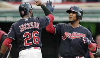 Cleveland Indians' Edwin Encarnacion, right, is congratulated by Austin Jackson after hitting a three-run home run off Baltimore Orioles starting pitcher Wade Miley in the first inning of a baseball game, Friday, Sept. 8, 2017, in Cleveland. Jackson and Yandy Diaz also scored on the play. (AP Photo/Tony Dejak)