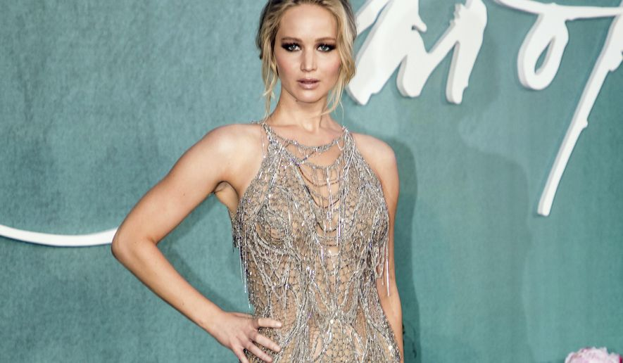 FILE - This Sept. 6, 2017 file photo, Jennifer Lawrence poses for photographers upon arrival at the premiere of the film Mother'', in London. Lawrence is facing backlash online for suggesting that monster hurricanes that just devastated Texas and another nearing Florida may have been prompted by Donald Trump becoming president.  (Photo by Vianney Le Caer/Invision/AP, File)
