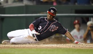 Washington Nationals' Michael Taylor slides home on his inside-the-park-grand slam during the third inning of a baseball game against the Philadelphia Phillies, Friday, Sept. 8, 2017, in Washington. (AP Photo/Nick Wass)
