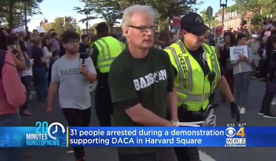 Professors from Harvard University and other Boston-area colleges were arrested Thursday while protesting against President Trump's plan to rescind an Obama-era program shielding young illegal immigrants from deportation. (CBS Boston)