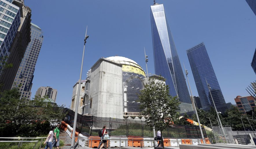 In this Aug. 10, 2017 photo, the St. Nicholas National Shrine, center, designed by renowned architect Santiago Calatrava, is under construction at the World Trade Center in New York. It is replacing a tiny Greek Orthodox church that was crushed by the Trade Center's south tower during the terrorist attacks of Sept. 11, 2001. (AP Photo/Mark Lennihan)