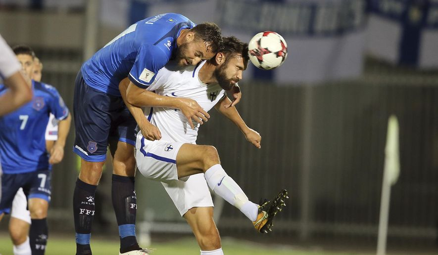 Kosovo's Atdhe Nuhiu, right, fights for the ball with Finland's Tim Sparv the World Cup Group I qualifying soccer match between Kosovo and Finland at Loro Borici stadium, in Shkoder, northern Albania, Tuesday, Sept. 5, 2017. (AP Photo/Hektor Pustina