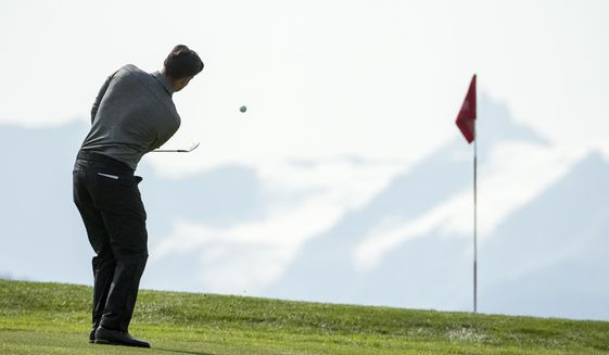 Lee Slattery of England tees off during the second round of the Omega European Masters Golf Tournament in Crans-Montana, Switzerland, Friday, Sept. 8, 2017. (Alexandra Wey/Keystone via AP)
