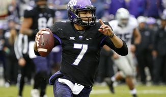 FILE - In this Dec. 3, 2016, file photo, TCU quarterback Kenny Hill (7) looks to pass during the second half of an NCAA college football game against Kansas State in Fort Worth, Texas. TCU plays at Arkansas on Saturday, Sept. 9. (AP Photo/Ron Jenkins, File)
