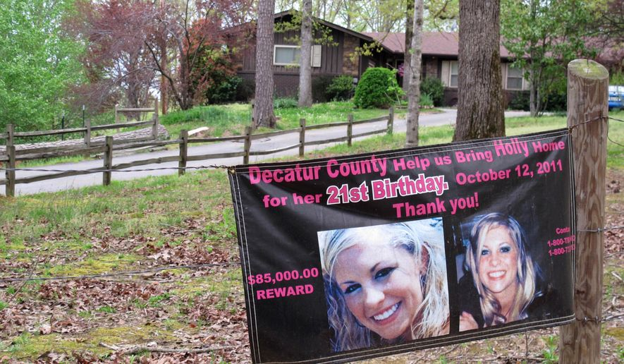 FILE - In this April 19, 2013 file photo, a poster with pictures of missing Tennessee nursing student Holly Bobo hangs on a fence in front of her house in Parsons, Tenn. On Monday, Sept. 11, 2017, Zachary Adams goes to trial for the murder, rape and kidnapping of Bobo, in a case that has gained national attention and shaken a small town to its core. (AP Photos/Adrian Sainz, File)