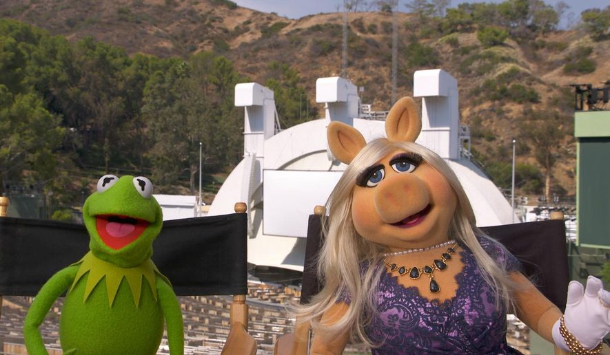 This image released by the Los Angeles Philharmonic Association and The Muppets shows characters Kermit the Frog, left, and Miss Piggy during a media availability at The Hollywood Bowl in Los Angeles to promote their first full-length live stage performance. he Muppets begin their three-night run at the Hollywood Bowl on Friday night. (Los Angeles Philharmonic Association and The Muppets via AP)